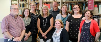 The library staff poses for a photograph