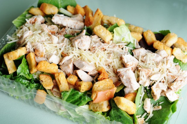 Caesar Salad with oven-fried shallots onions and grilled chicken breast