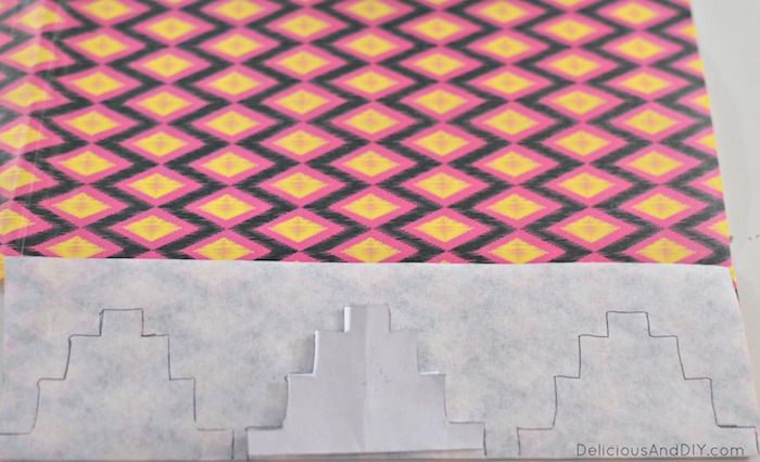 cutting out aztec design from decoupage paper