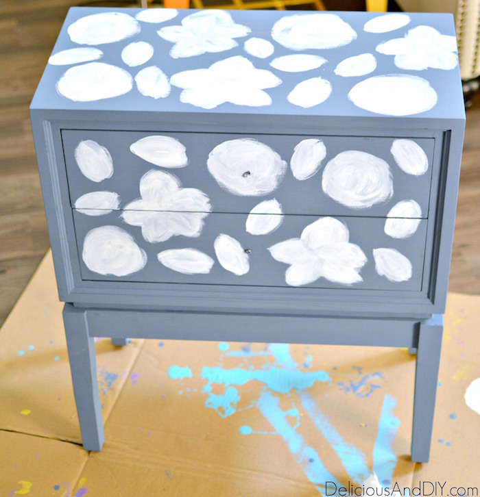 Create this whimsical flower pattern on a plain piece of furniture and completely transform it. You don't need to be an artist to create a Flower Art Nightstand| Home Decor| Painted Furniture| Repurposed Furniture| Flower Art pattern| Handpainted Furniture| Nightstand Makeover| Furniture Makeover Ideas