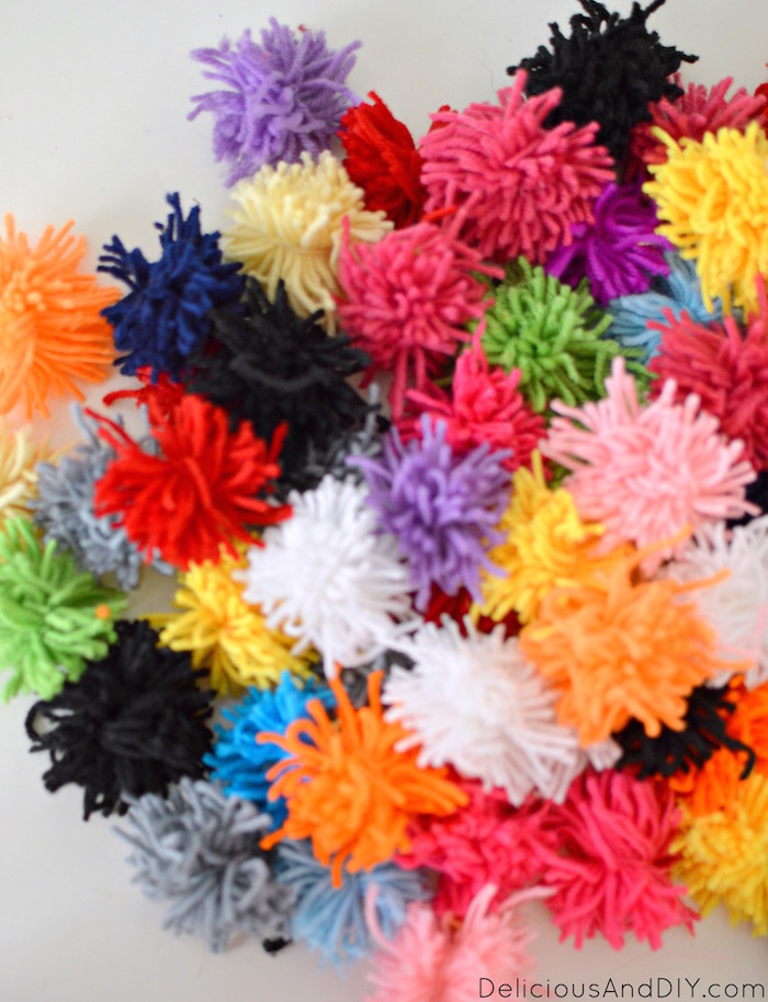 Create this unique Pom Pom Earring Display using Yarn| DIY Crafts| Pom Pom Projects| Home Decor Ideas| Pom Pom Projects| Yarn Projects| Earring Display Crafts| Earring Display Ideas| DIY Earring Display| Colorful Earring Display made with Pom Pom