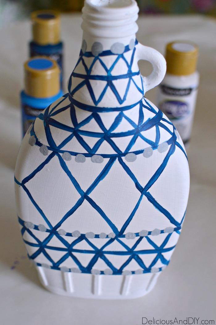 Paint grey circles around the DIY Anthropologie Inspired Vase