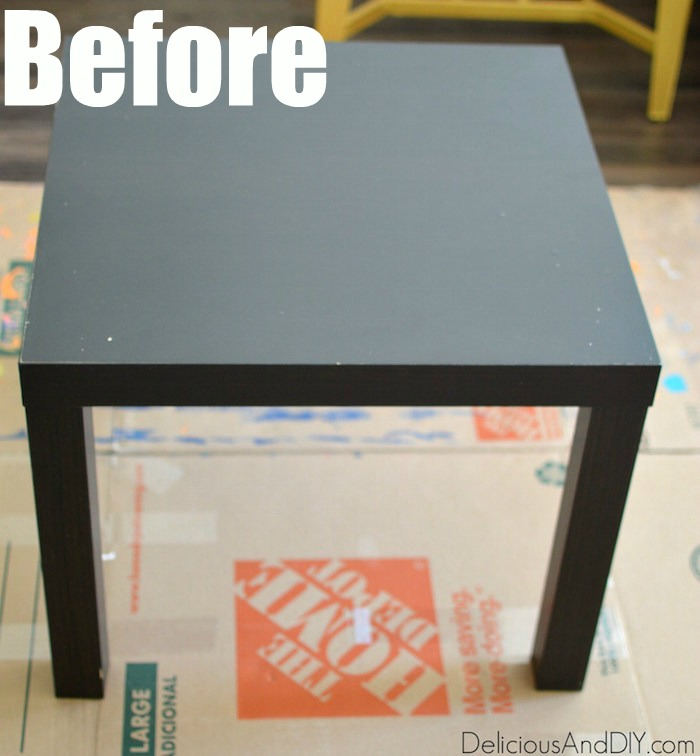 A black IKEA Lack Table before it is stenciled and painted