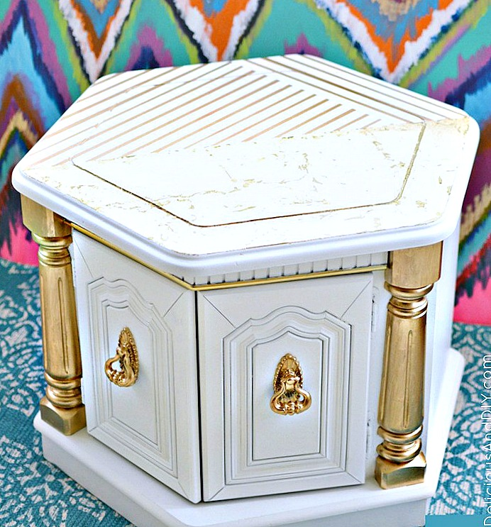 A side profile picture of a Hexagon Shaped White and Gold Coffee Table