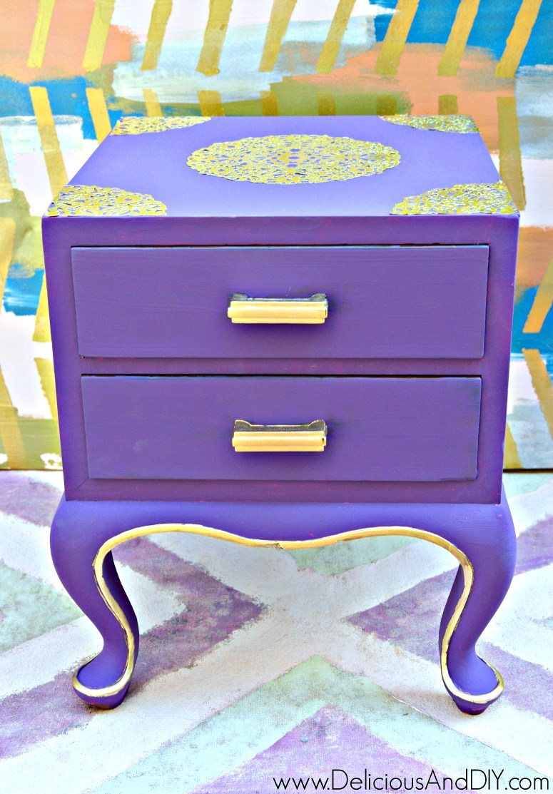 A purple painted nightstand using paint and Gold Doily