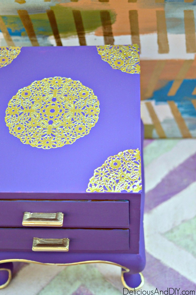 an aerial picture of a purple chalk paint thrifted nightstand