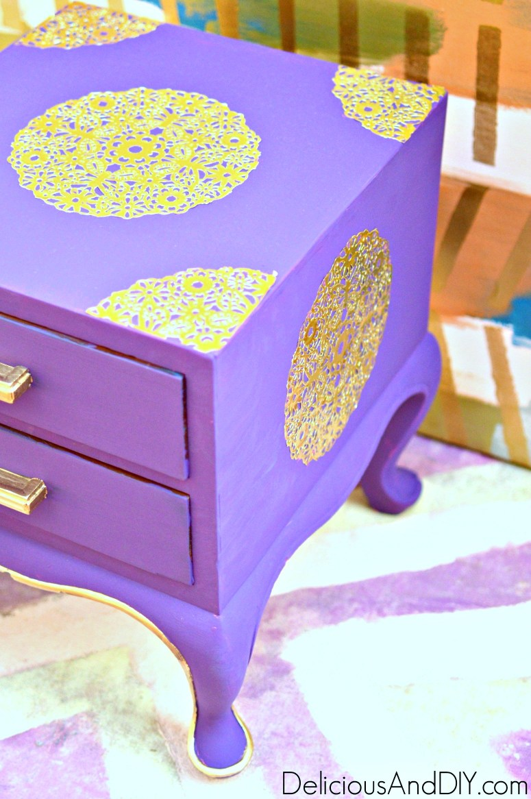 gold doily decoupaged onto a thrifted nightstand