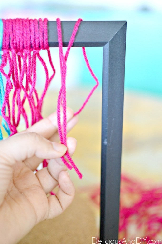 looping the yarn around the frame