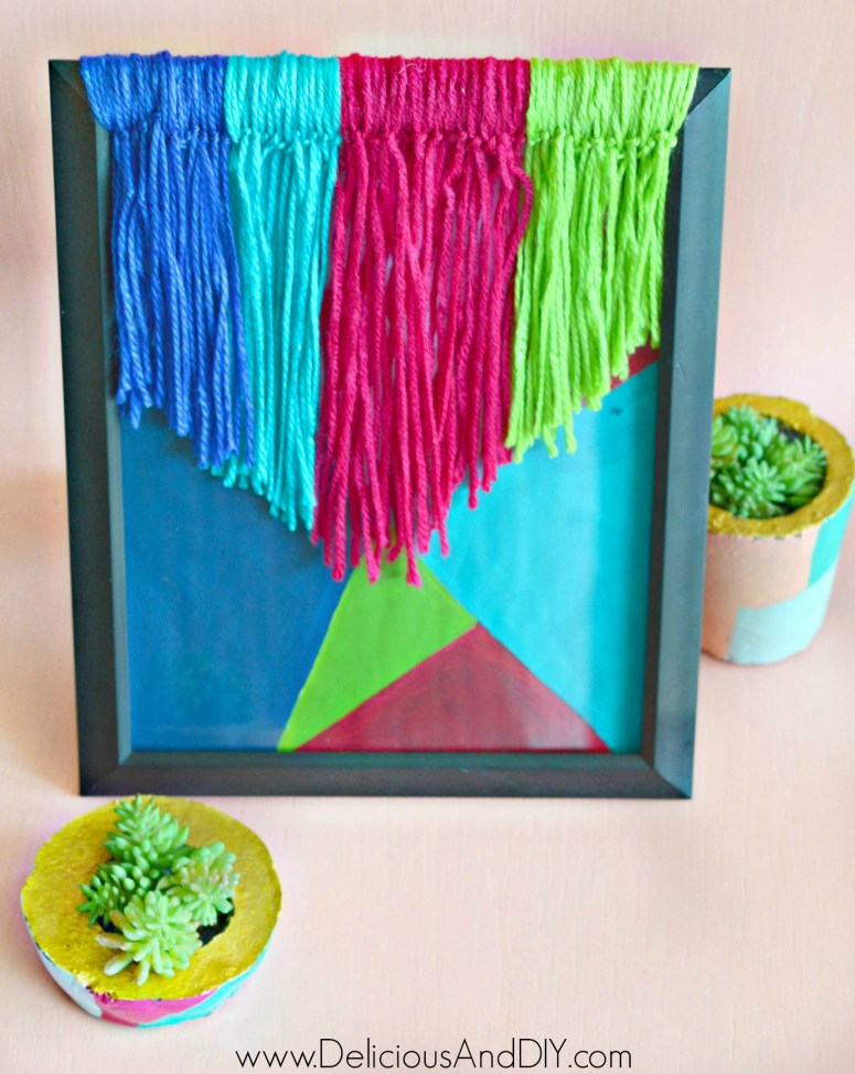 colorful yarn wall hanging