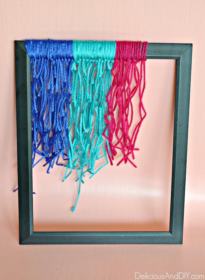 tying yarn around frame