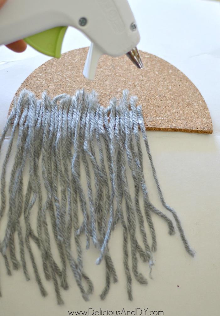 glue yarn onto cork coaster ornament