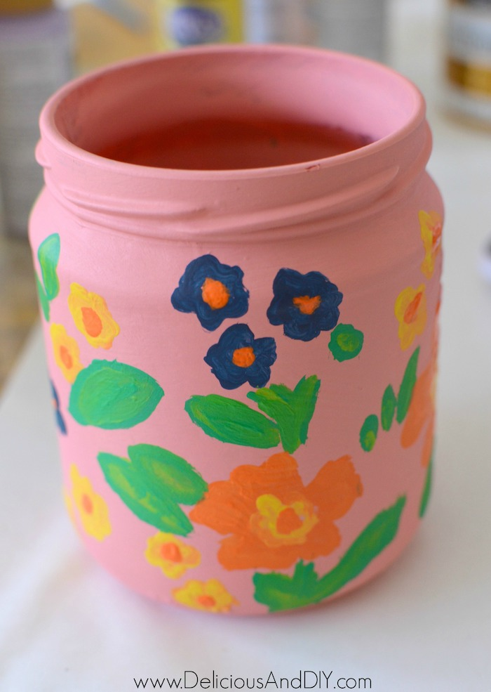 painting flowers on the jar
