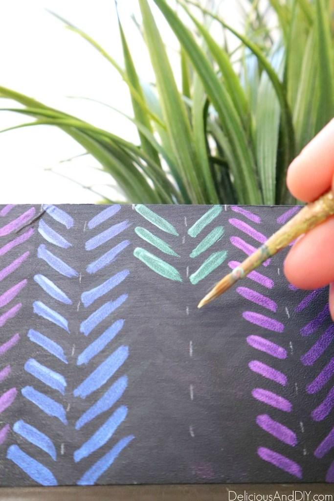 painting green iridescent paint on planter