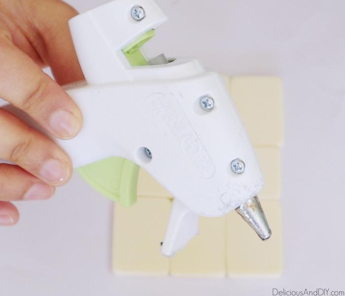 hot glue gun to attach the board game pieces