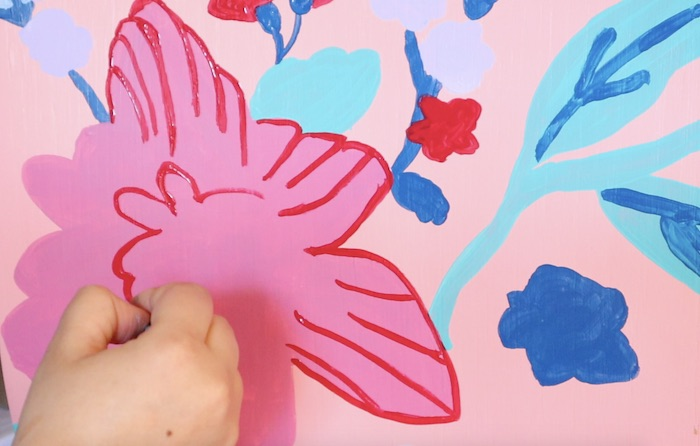 adding smaller flower details onto the pink flower
