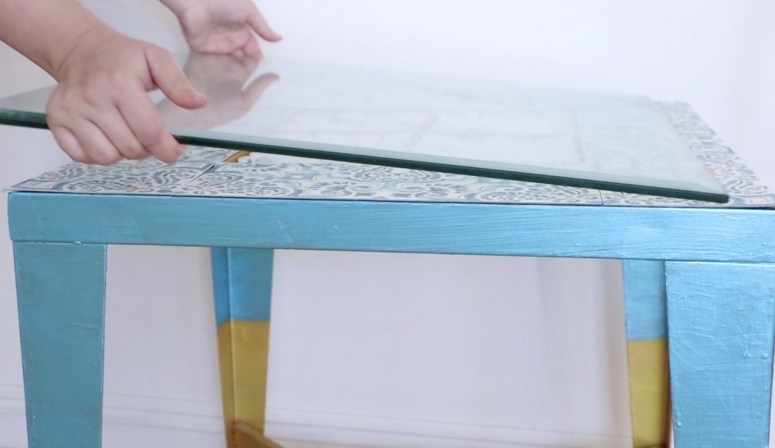 placing glass onto the thrifted table