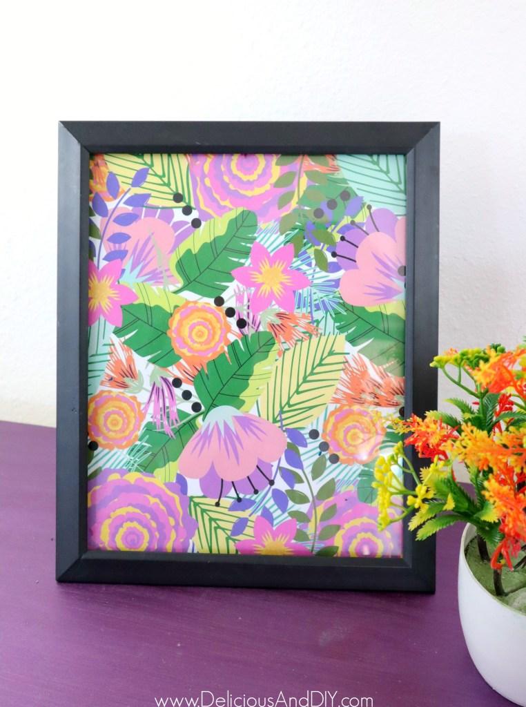 floral print in a black frame