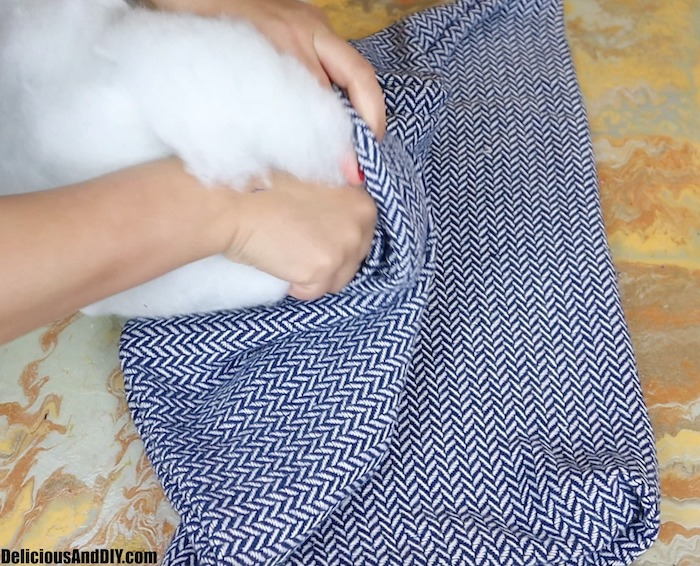 adding stuffing into throw pillow cover
