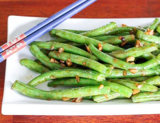 These Fresh Asian-Style Green Beans are deliciously garlicky and complex in flavour. They're simple to prep and ready in just a few minutes. Whether you're looking for creative ways to add more veggies to your plate or have tons of green beans on your hands from your garden, give them a try!
