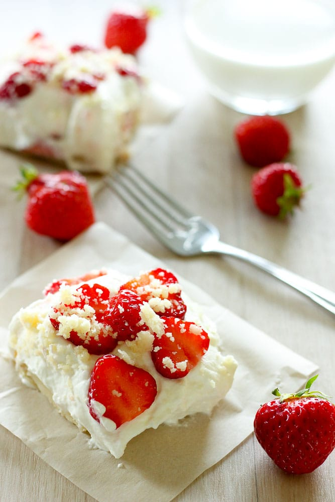 These Fresh Strawberry Shortcake Bars combine a rich, buttery shortbread base, a fluffy vanilla cream and fresh summer strawberries into a heavenly summer dessert. Easy to make and completely addictive, they're the perfect plan for all those sweet strawberries you have in the fridge.
