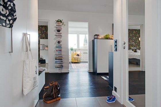 piso bien aprovechado hall integrado en el salón estilo nórdico diseño pisos sin pasillo decoración escandinava blanco decoración diseño espacio abierto decoración diseño de pisos pequeños medianos blog estilo decoración nórdica