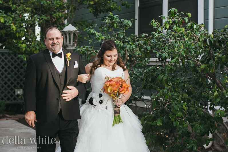 proud father of the bride walking his daughter down the aisle