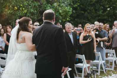 photograph of bride and father from behind