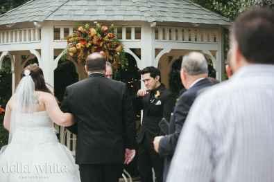 groom getting emotional at christmas house inn