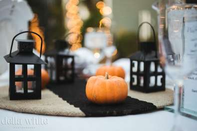 fall wedding table decor with pumpkins and lanterns
