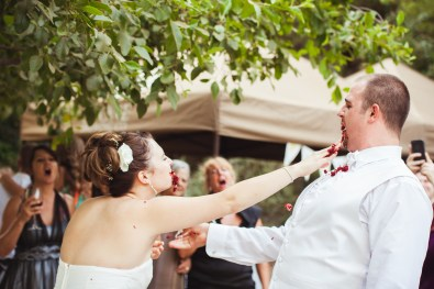 bride smashing cake in the grooms face