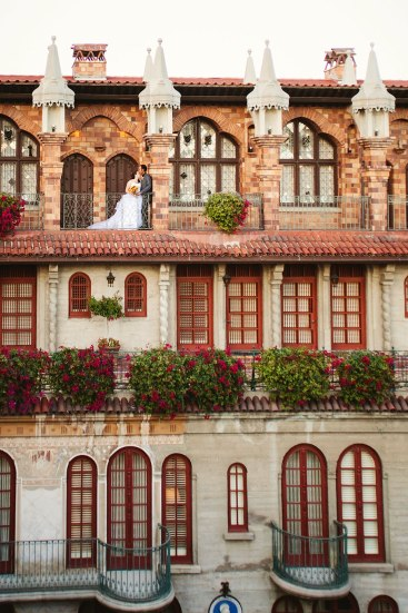 bride and groom in the halls of mission inn
