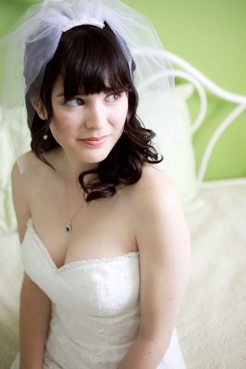 bride getting ready in her childhood bedroom