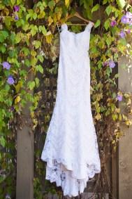 wedding dress hanging in ivy