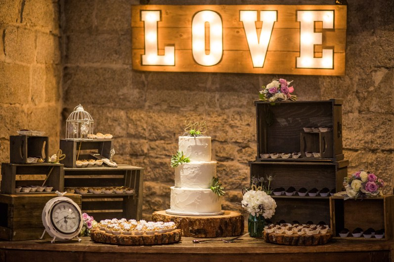 dessert table set up with love sign