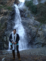TRAVEL BUG: Ambalal in front of a waterfall on one of her many trips. Ambalal loves to travel around the world. COURTESY PHOTO