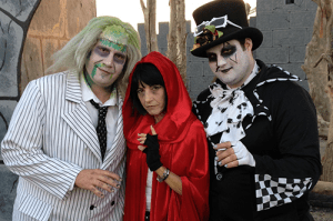 IN FOR A SCARE: Clockwise, Danelle Ferrari and her brothers stand outside the haunted house. PHOTO BY VALERIE SMITH