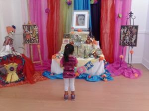 DIA DE LOS MUERTOS: A girl looks at an ofrenda  dedicated to Frieda Kahlo. PHOTO BY SANTANA JUACHE