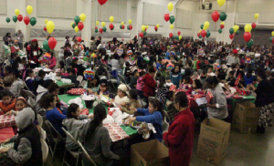 PRESENTING PRESENTS: Children enjoy themselves at the  Christmas presents distribution event at the San Joaquin County Fairgrounds. PHOTO COURTESY OF ANTOINETTE FOUTZ-CONTRERAS