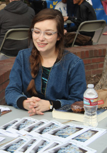 NEW ERA, NEW EDITOR: Summer Migliori runs the table for the Writers' Guild during Club Rush on Feb. 4. PHOTO BY JERMAINE DAVIS