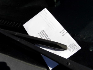 A parking ticket is found on the windshield of an illegally parked car in Cunningham 5 parking lot.
