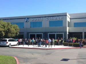 Former Heald College students waited in line at the Stockton branch to learn about their options for transferring.   PHOTO BY VORANI KHOONSRIVONG