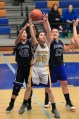 Fiola Dema #20 of the BRHS JV Warriors grabs a rebound in between two Nome defenders during last weekend's games at the WarriorDome.