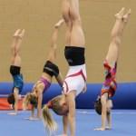 Kids learning handstands - fundamental gymnastic skill