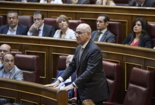 Secretary general of the Catalan Convergence and Unity party (CiU) Josep Antoni Duran i Lleida abstains from voting in Spain's lower house of parliament on June 11, 2014 during a session to vote on the bill allowing the abdication of King Juan Carlos with the senate following suite on June 17.  Both the ruling Popular Party and opposition Socialists back Felipe's succession, Spanish lawmakers are then expected to swear in the 46-year-old future King Felipe VI at a ceremony -- to which no foreign dignitaries have been invited -- on June 19, although the date has not yet been finalised.  AFP PHOTO / DANI POZO        (Photo credit should read DANI POZO/AFP/Getty Images)