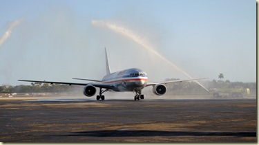 The airplane carrying the UF football team taxis through streams of water from fire trucks as part of the arrival ceremonies at the Fort Lauderdale / Hollywood International Jet Center on Friday, January 2, 2009 (Harrison Diamond / Alligator Staff).