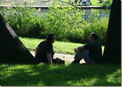 Couple talking park in Germany