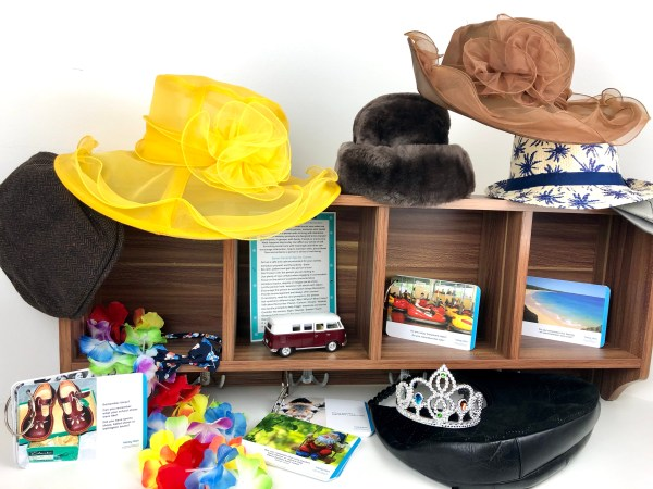 Hat Rack with hats & conversation cards to prompt reminiscence