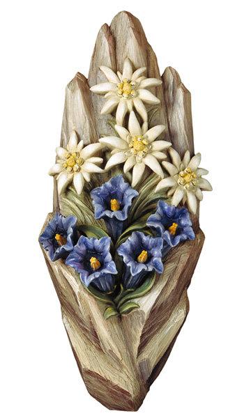 Rilievo stella alpina Orologi a cucu  presepi  sculture