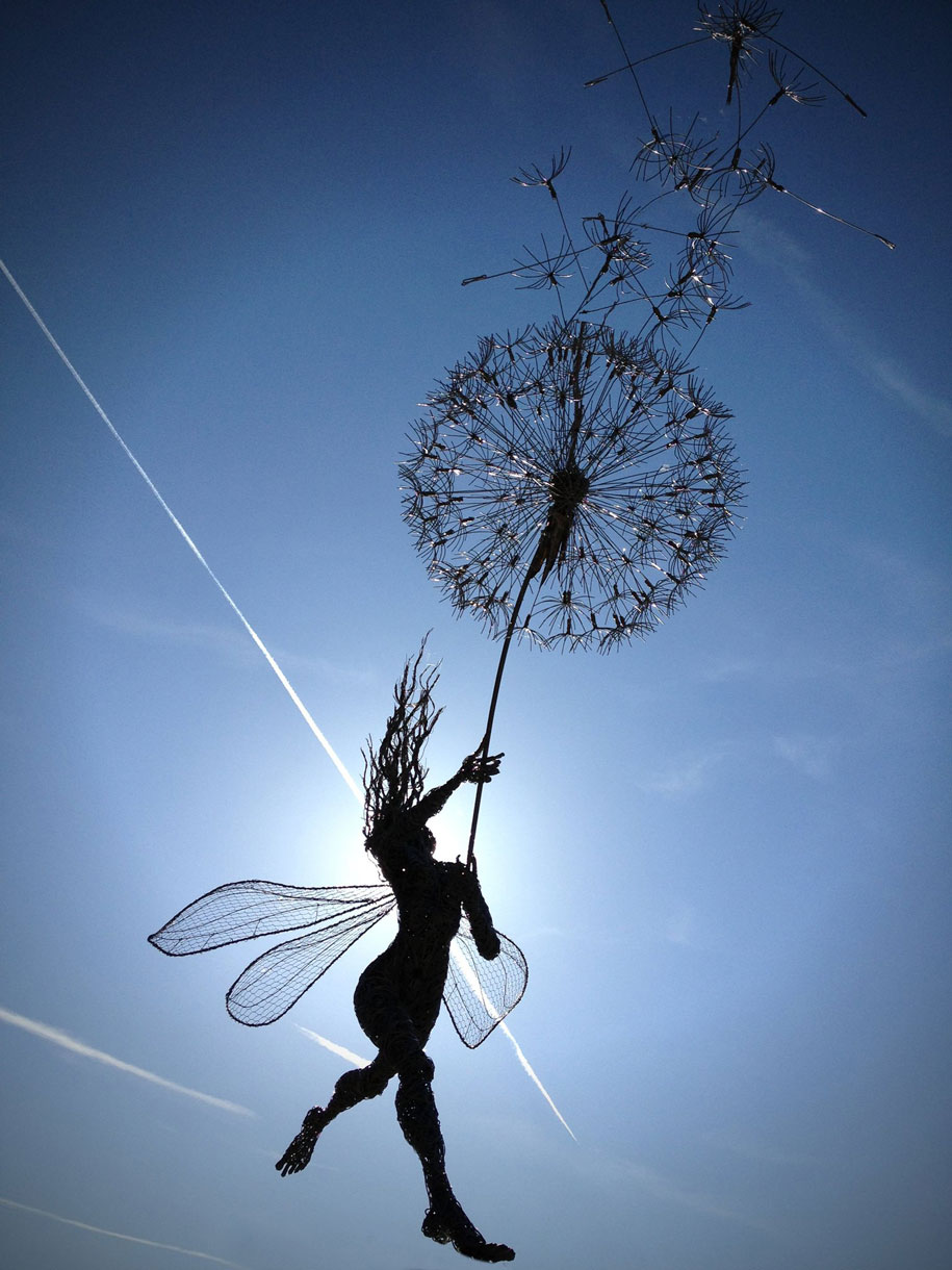 fairy sculpture, fairy, dandelion, flower, sky, blue, petals, seeds, wings, fantasy, authorblog, blogseries, adventure, mustread, goodreads, booklove, lovetoread, what to read, books, reading, writing, fantasy author, YA author, MG author,