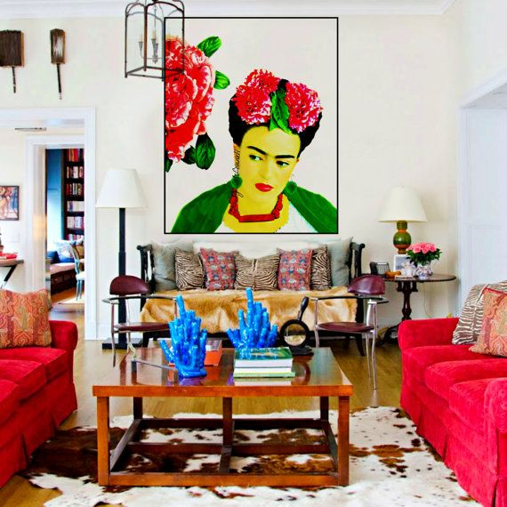 Frida Kahlo - her style was colourful, eclectic, bohemian, vibrant, and adorned with her many paintings of herself. Let's honor this brilliant artist and take a look at some of her work, a few Frida Kahlo inspired interiors, and how you can add her flair into your home! #globalhomedecor #bohemianinteriors #fridaykahlo